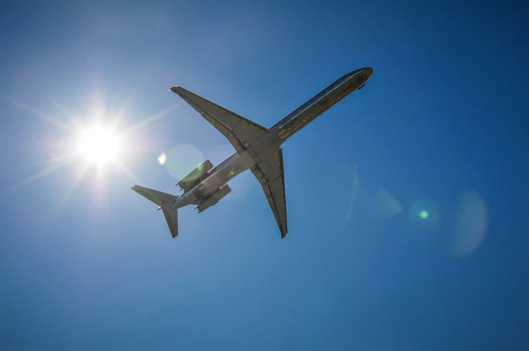 jet-airplane-in-the-sky-with-sun